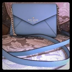 Kate spade envelope shoulder bag It is a baby blue color. Used once to a dinner so it is in excellent condition. It was supposed to be a gift to my daughter but she wanted something else and I forgot to return this so I tried to make it work but it's too small for me. You can wear it cross body or on the shoulder or take out the strap and you can use as a clutch. Very elegant. Comes with dust bag kate spade Bags Crossbody Bags