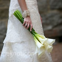 Calla Lily Bouquet  A green leaf bound together Sarah's bouquet of sleek white calla lilies.