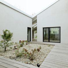 Triendl und Fessler Architekten plans low-cost family home around a secret courtyard