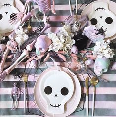 A perfect mix of spooky & pretty skull & bones Halloween tablescape. via TGIF were playing around with this boneyard tablescape for an upcoming haunt! Love how this repurposed striped linen turned out after we doused it in paint . Halloween Chique, Pink Halloween, Halloween Queen, Halloween Birthday, Halloween Party Decor, Holidays Halloween, Halloween Costumes For Kids, Halloween Treats, Halloween Table Decorations
