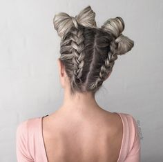 Reverse braids into space bow buns by Nina Starck