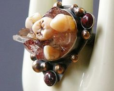Own your own real human tooth - and wear it as jewelry!  http://www.etsy.com/listing/117574988/busted-lip-ring-made-with-real-teeth-and?ref=market