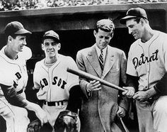 Ted Williams, Eddie Pellagrini, John F. Kennedy, and Hank Greenberg talk baseball prior to a Red Sox game at Fenway Park in 1946. The 29-year-old Kennedy was campaigning for a congressional seat.