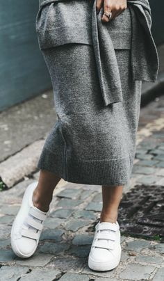 A matching top and skirt set will look cool and edgy with plain white sneakers. Via Sara Escudero.  Top/Skirt/Sneakers: Sandro Paris, Bag: Chanel Vintage.