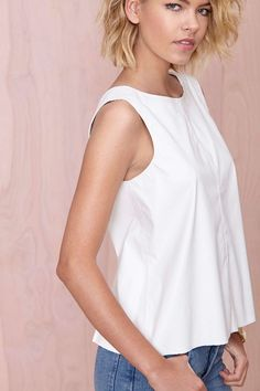 Cute white top. Maybe add a lace over hang or v-back lace
