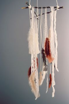 11. Create an entrancing feather mobile with the help of some found twigs.