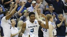 Xavier  players including Jalen Reynolds (1) celebrate during the closing minutes of an NCAA tournament third round college basketball game against Georgia State, Saturday, March 21, 2015, in Jacksonville, Fla. Xavier won 75-67.(AP Photo/Chris O'Meara) Xavier Basketball, College Basketball, Jacksonville Fla, Ncaa Tournament, March 21, Feel Good, Georgia, Third, Running