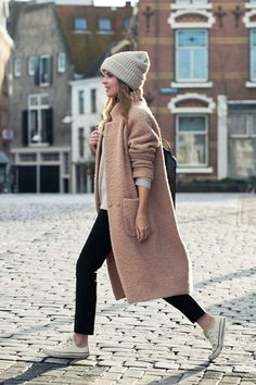 ribbed beanie, blush pink coat, cropped black pants and white Converse