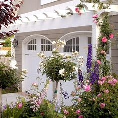 I love a good pergola anywhere!  It adds so much to this exterior; architecture, blooming flowers and beauty.   Every home needs one! my-better-homes-garden-dream-home