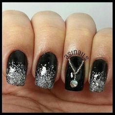 Silver Glitter Nail Design with a Necklace Accent.