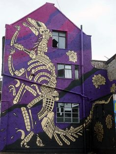 Croft Fossil by Andy Council -- Painted on Jamaica Street Bristol in the Stokes Croft area. Dino skeleton is made up of buildings from around those parts.