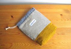 約 タテ19.5cm(袋口含まず)ヨコ17cm マチ5cm本体:綿裏地:綿*コップ入れや小物入れなど多目的に使っていただける巾着袋です。*永く使って頂けるよう...|ハンドメイド、手作り、手仕事品の通販・販売・購入ならCreema。