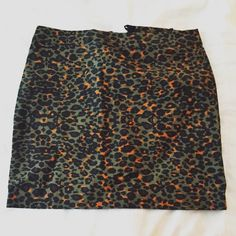 H&M Leopard Army Green skirt Mini pencil skirt, zipper back with button clasp, army green and black leopard print with rust colored accents. H&M Skirts Mini