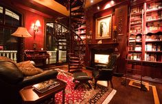 Dream home library. Look at that spiral staircase, plus there's also a bookshelf ladder.