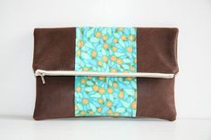 colorblock vegan leather foldover clutch in teal and brown