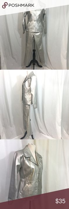 Vintage Silver 2 pic Disco Space Suit Costume S EUC. This an amazing find . It has so many possibilities. Material is polyeurathene and relatively thick. Might also make a great Ladies tin man costume. Top is a small Shown on size 6 dress form. Bust 38 Shoulders 17 Length 25 Pants 5/6 Waist 28 Inseam 30 whats this Jackets & Coats Blazers