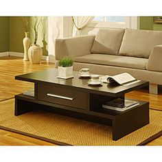 This gorgeous Tepekiie coffee table offers a rich coffee bean finish and an accessible drawer on both sides. The coffee table features a unique design and would be an beautiful accent piece in any living space.