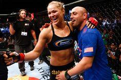 UFC bantamweight champion Ronda Rousey celebrates a win with Manny Gamburyan (Getty)