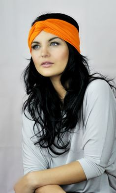 Burnt Orange thick fabric headband worn by model with blue eyes and long dark  hair