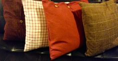"""Floor pillows made from upholstery remnants. Button/zipper closures. Down-filled. 20"""" x 20"""""""