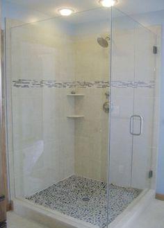 Slight step up, non-slip surface, tiles exposed outside of shower frame along walls