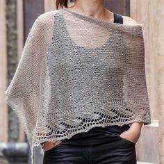 Free Knitting Pattern for Emilia Poncho - This lace edged poncho is knit as a rectangle and seamed. Designed by Emilia Menéndez. Available in English and Spanish. Poncho Shawl, Knitted Poncho, Knitted Shawls, Poncho Knitting Patterns, Knit Patterns, Free Knitting, Diy Tricot Crochet, Crochet Shawl, Pulls
