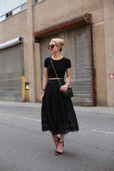 black crop top, black cross body bag, full black lace skirt, black sandals