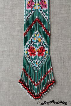 This Gerdan-style necklace is handmade from high-quality Czech beads and strong synthetic thread. It is an original creation based on traditional Eastern European folk motifs and patterns. This elegant and fashionable necklace is highly versatile, suitable both for everyday wear and formal occasions.  Features: Color: red, black, white, green, blue. Length (approximate): 54 cm (21.28 in) Width (approximate): 7 cm (2,758 in) Once purchased, it will be shipped from Ukraine within one to two…