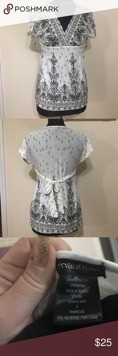 """Maurice short sleeve top White with black design. Empire waist has a small bit of elastic and a tie in back. Vneck and slightly fired. Total lengths 26 shoulder to him across bust from armpit to armpit is 17"""". Feminine and flattering blouse. Maurices Tops Blouses"""