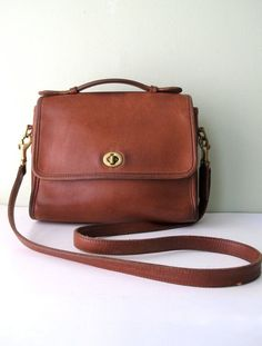 the vintage Coach purses were made to withstand a nuclear blast.  the ones today look like cheap pieces of crap.  sad :(