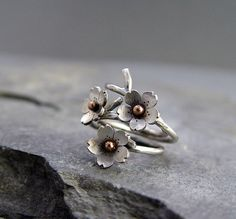 Cherry Blossom branch ring. So pretty! I also like the ring with the single Cherry Blossom on it.