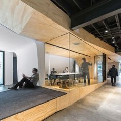 Converted+warehouse+office+by+Domaen+features+sculptural+plywood+meeting+rooms