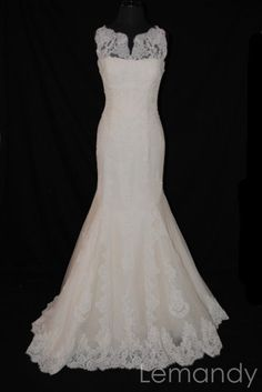 classy ivory strapless mermaid lace wedding dress. $308.00, via Etsy. Oh my... Definitely feeling a lace dress