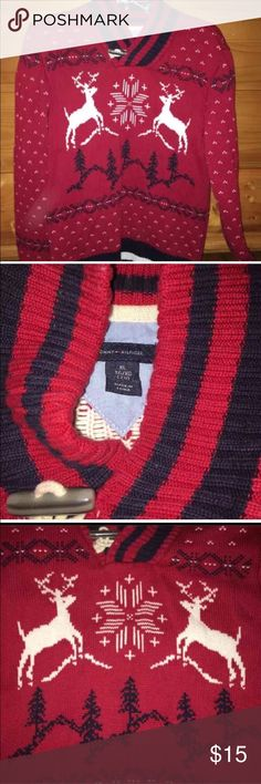 """Holiday Party Sweater Tommy Hilfiger Reindeer Boys Tommy Hilfiger Sweater Red Holiday Reindeer Thick Knit Toggle Neck Boys Size XL   Measures approx 18"""" from underarm to underarm 24"""" long. Red with Reindeer and Winter scene with blue and white. Thick knit cotton with toggle at neckline. Tommy Hilfiger Shirts & Tops Sweaters"""