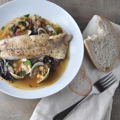 Butter-basted seabass with clams and chorizo broth... better than restaurant quality meal you can make at home.