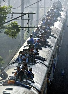 India. This is remarkable to witness, although here in South Africa people hang out of the doors of our trains!!!