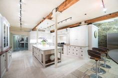 With handmade drawers and cabinets, this traditional kitchen would suit both modern and period houses.