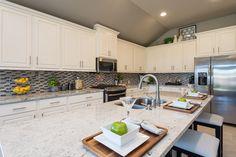 New Model Home Now Open in Austin's Teravista - 2,420 Sq. Ft. - Kitchen - #PerryHomes #PerryHomesTexas #Teravista #GeorgetownISD #GeorgetownTX #Austin #AustinHomes #TexasHomes #trustedbuilder #homedecor #homedesign #moderndecor #modernhomedesign #landscaping #lakesidecommunity #lakeside #waterfront #lakefront #breakfastarea #kitchen #countertops #cabinets #backsplash #splashback #kitchenislands #breakfastbar #whitekitchen