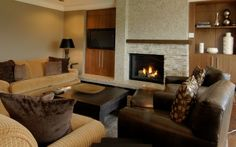 Another option is putting cabinets on either side of stacked stone over fireplace with thick mantel