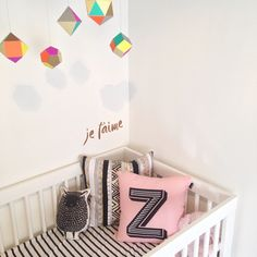 MOdern black white & color nursery with custom monogram pillow and mobile by The Sweet Escape.