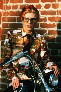 Photographs by Steve Schapiro, from Bowie, published by powerHouse Books David with goggles and bike. Los Angeles, 1974.
