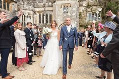 Wedding couple showered with confetti out side Athelhampton House in Dorset Wedding Dj, Wedding Couples, Wedding Ceremony, Wedding Venues, Pale Blue Dresses, Wedding Confetti, Bridesmaid Dresses, Wedding Dresses, Newlyweds