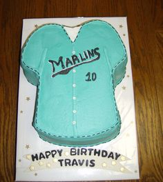 Baseball Jersey - 2-Layer French vanilla with dream whip buttercream.  This was for a 10-year old's birthday party-his little league team is the Florida Marlins.  I loved making the itty-bitty fondant buttons - they were fun!  I was so happy I had ordered Americolor Teal from Cake Central - it was so much easier than trying to mix colors to get the perfect shade!  Thanks Cake Central!