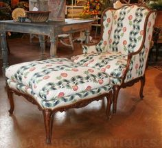 Louis XV style walnut wing chair and poof