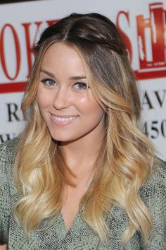 Want Lauren Conrad's boho look? Grab two thin sections a few inches back from your hairline, twist, and secure with pins at the back of your head. For her glossy waves, use a jumbo curling iron. Jesse Grant/WireImage.com -Cosmopolitan.com