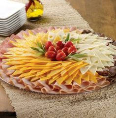 When you have a party, you must have a meat and cheese tray, right? Order a Di Lusso Tray featuring the finest sliced meats and cheeses. Perfect for cocktail sandwiches or with assorted crackers.