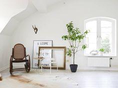 white apartment greens living room