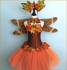 The Autumn Glory Goddess is at once regal and spectacular. The finest, most festive foliage in the woodland has been used to create her headpiece,