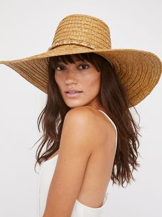Palapa Straw Hat | Floppy straw hat with a statement wide brim and tall crown.    * Metallic band with tassel ends   * Adjustable circumference