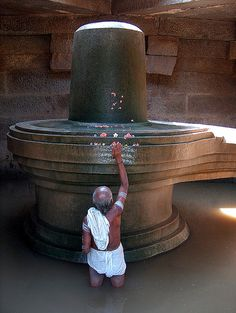 """Shiva lingam, Hampi (by Simbo Benbo) - Shiva-Lingam as found on almost every street corner in India. The union of lingam and yoni represents the """"indivisible two-in-oneness of male and female, the passive space and active time from which all life originates"""". The lingam and the yoni have been interpreted as the male and female sexual organs by some scholars, while to practising Hindus they stand for the inseparability of the male and female in the totality of creation."""